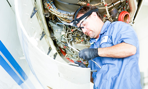 Man working on Aircraft Engine
